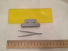 стекло защитное на кронштейне желтого цвета, от микроскопов серии  Люмам